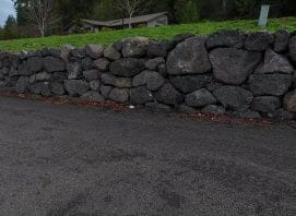 Rock wall created by Jamestown Excavating in Sequim, WA.